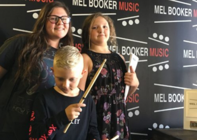 Mel Booker Music Students at the store