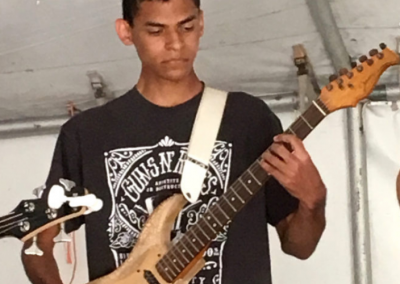 Mel Booker Music Student performing at a Rock Shop